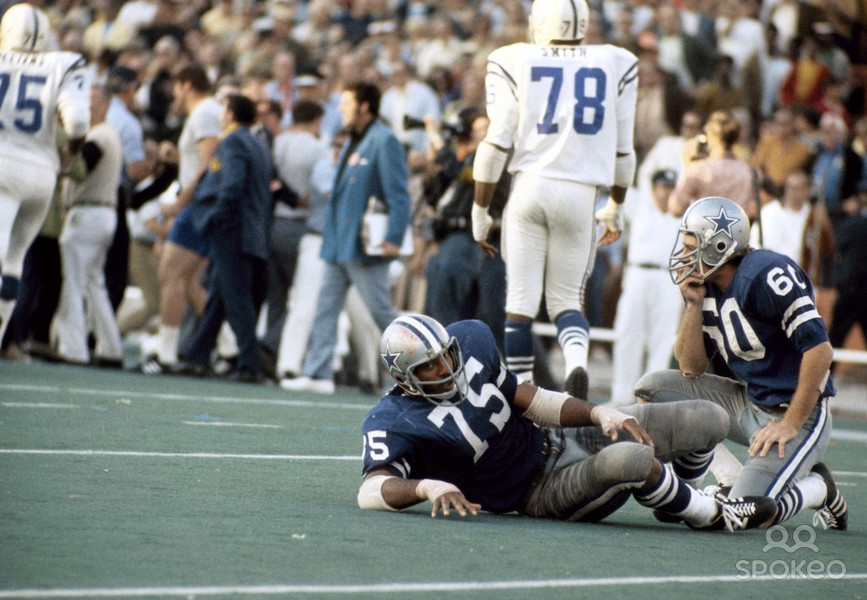 Dallas Cowboys defenders Jethro Pugh (75) and Steve Kiner are stunned on the floor of the Orange Bowl after Jim O'Brien's winning field goal in Super Bowl V. (Credit: Spokeo.com/Sports Illustrated)